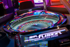 FUSION™ AUTO-ROULETTE offers automated roulette gaming on a sleek & compactly designed six wide-screen ergonomic player positions, each with a free view of the wheel and maximum operational security.